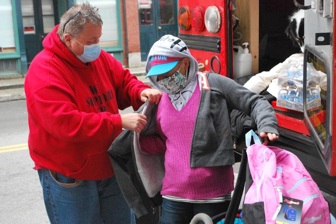 Peter Kelleher Helps Homeless Woman